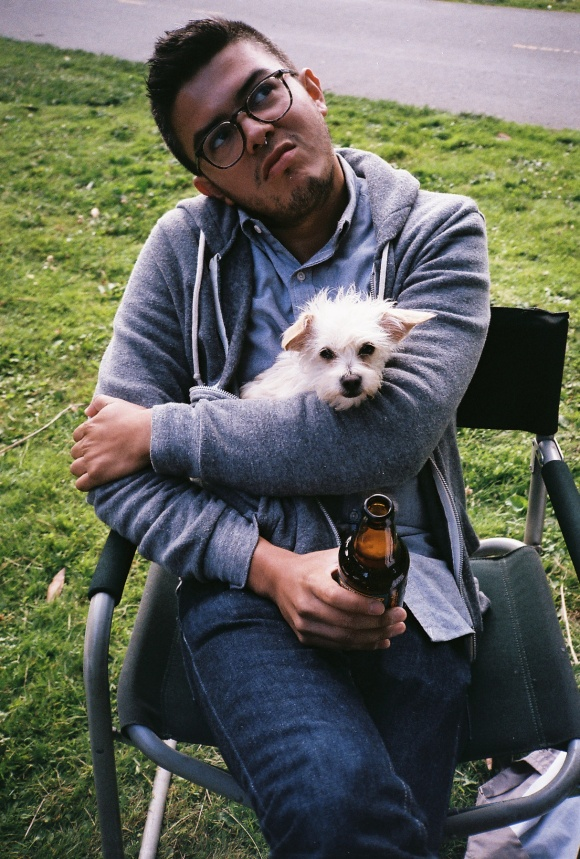 A boy, his dog, and his beer